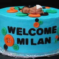 "Cute As A Button 8"" Cookies & Cream cake decorated with fondant buttons to welcome Baby Milan."