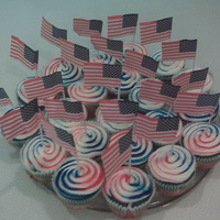 Fourth Of July Cupcakes Layered Red White and Blue cupcakes with striped white chocolate buttercream