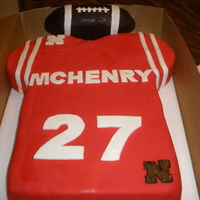 Football Jersey Cake Lemon cake w/lemon BC. Covered with Duff's red fondant. Football was RKT covered w/modeling chocolate. MMF accents. Inspiration from...
