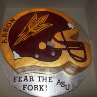 Asu-Arizona State University Football Helmet cake cut into the shape of a football helmet and and made a helmet out of sugar clay to lay on top of the cake and all details done by hand...