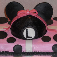 Minnie Mouse Cake   I made this cake for my daughter's birthday. It has pink buttercream Icing with fondant ears on the hat, ribbon and dots