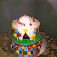 Let's Go To The Circus Bottom tier is vanilla cake covered in crusting buttercream with fondant accent and gum ball border. Top tier is chocolate cake covered in...