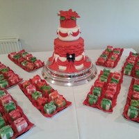 4 Tier Christmas Wedding Cake And 80 Mini Fruit Cake Parcels   10,8,6 & 4. Fondant drapes and billowing. Fondant poinsettia topper.