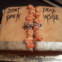 Walking Dead Cake   For my daughter, a huge fan of the programme.Toffee and chocolate cake, all fondant decorations.