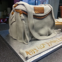 Marc Jacob Hand Bag Cake Lemon cake with lemon buttercream. All fondant decoration.