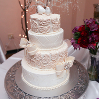 Ivory Lace Wedding Cake Round cake with ivory fondant lace details and bows. photo courtesy of dusty gorman photography