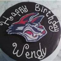 Hockey Puck Cake With Jackal Mascot This is a chocloate cake with chocolate ganache filling and whipped ganache frosting. Then I covered with a chocolate lid and chocoalte...