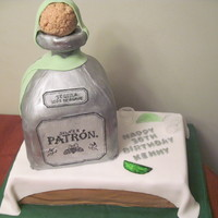 Silver Patron Bottle Cake Silver Patron Bottle cake. Fondant covered chocolate base cake and vanilla patron bottle with RKT for bottle cork. Gumpaste limes and...