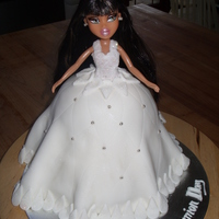 Communion Bratz Cake Originally meant to be a barbie cake but couldn't find a brown haired barbie so used this bratz doll instead. The cake is vanilla with...