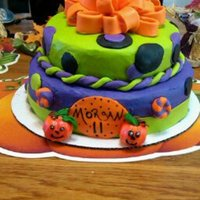 Halloween Birthday Cake It has Butter Cream Frosting And Fondant accent with a fondant bow. I also used a eatable marker to write on the fondant and made the...