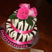 Zebra Bridal Cake Chocolate Fudge Cake with Chocolate Ganache Filling, WC Fondant, Dark Chocolate Stripes. Pink Satin Ribbon with Real Roses on top.