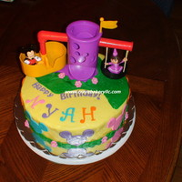Mickey Mouse And Dora Themed Cake This cake was a challenge for me. The customer wanted a Dora and a Mickey Mouse themed cake, so I struggled with the design. I tried to...
