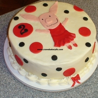 Olivia The Pig Cake Buttercream with fondant accents