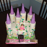 "Castle Cake 4 Layers 10"" Chocolate, Vanilla, Buttercream Filling, Covered with MM Fondant. Entire Cake is edible. Towers are RKT and princess is..."