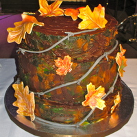 Chris' Grooms Cake Tree stump grooms cake with barbed wire and fall leaves.