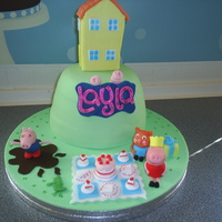 Peppa Pig! Peppa pig cake made for a friend's little girl who turned 2 today. She loves peppa pig! The house on top is RKT, and the cake itself...