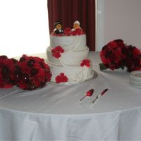 Rubber Duckie Wedding Cake 3 tier fondant covered cake with fondant roses and draping
