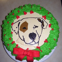 Happy Howl-Idays I made this cake for my brother. His dog is his child. The image is a BC Transfer. The holly is made with fondant. Thanks for looking :)