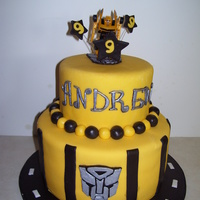 Bumble Bee Birthday cake covered in MMF, the logo and name are hand painted with silver luster dust. All edible except for the figure on top. Thank you for the...