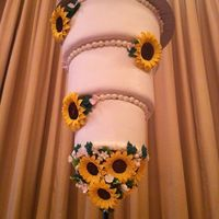 Upside Down Sunflower Cake This cake wAs and upside down cake. All cake no stirofoam. The bride wanted something different