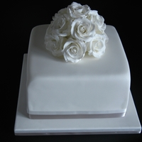 White Wedding Cake Handmade roses for a very elegant but small wedding cake.