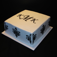 Black Damask Stencil On White Buttercream With Monogram This is a 10 inch square cake. White Vanilla Cake with White Buttercream Frosting. Strawberry Fruit Filling. Black Damask Stencil and...