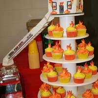 Fireman Burning House Cake With Flame Cupcakes For Grooms Party Fireman Burning house cake with flame cupcakes for groom's party.