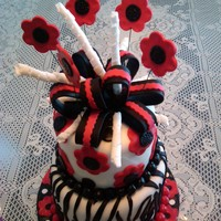 Zebra Cake With Red Flowers Zebra cake with fondant and gumpaste decorations.