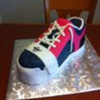 Creative Recreation Shoe This is a carved cake covered in fondant.