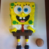 Spongebob!!! I made this from a quarter sheet pan. Decorated in fondant and I used a small roller to press in the sides to make him lumpy. The krabby...