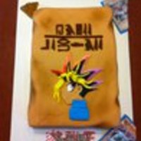 "Yu-Gi-Oh!!! The egyptian tablet was made from a quarter sheet pan, I used powdered food coloring for the airbrush look. The hieroglyphs say ""happy..."