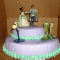 Princess And The Frog My grand daughter wanted us to make this cake for her birthday since she loves Princess and the Frog. Cake covered in Fondant with...