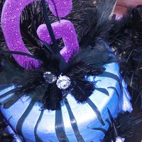 Diva Bling Two layer basic white yogurt cake covered in purple buttercream; black zebra stripes in buttercream flavored fondant; decorations include...