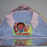 Dora The Explorer Bag Fruit cake with fondant and printed sugar paper.