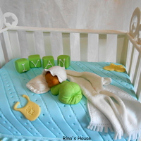 Baby Bump Baby Cot Baby shower cake to welcome home a new baby boy....Cot rails are all fondant,baby made with Karen Davies mold.