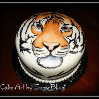 Kymee's Tiger This is a white cake with vanilla filling, frosted with buttercream icing and then covered in MMF. I painted the tiger on the MMF with...