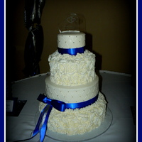 "Royal Blue And Rosettes This is a 5"", 8"", 11"" and 14"" cake. All buttercream, rosettes and quilte pattern with silver dragees. Thanks for..."