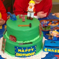 Bob The Builder The top tier is chocolate cake filled with buttercream and covered in fondant and the bottom tier is vanilla. All figures made from fondant...
