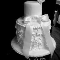 White Rose Petal Cake   This is a two tier cake with gumpaste rose petals