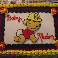 "Little Fireman 12x18 sheet cake, buttercream with a FBCT, black fondant ""frame"""