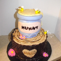 Pooh's Hunny Pot 10 inch chocolate cake with buttercream, bark is mint chocolate ganache top is vanilla cake carved, iced in buttercream and covered in...