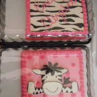 Emily Elizabeth Two seperate cakes, one vanilla, one chocolate, made to match the baby bedding. Buttercream icing, fondant zebra colored with edible marker...