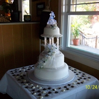 Round Tier Wedding Cake Round Tier lighted wedding cake with fondant flower sprays
