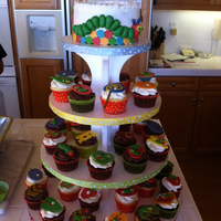 Very Hungry Caterpillar Cake and matching cupcakes based off the book Very Hungry Caterpillar