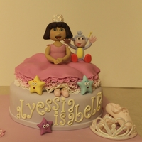 Princess Dora's 1St Birthday! Two tier Vanilla cake filled with buttercream. Fondant/gumpaste Dora, Boots and details.