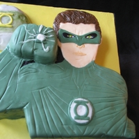 Green Lantern Birthday Cake   Make this for my nephew's 6th b-day. Green Lantern character and planet are white cake with vanilla SMBC and fresh strawberries.