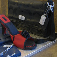 Coach Purse Cake  This cake is for a bachelorette party and is intented as a joke/surprise cake. The person the cake is for likes to use safety pins to hem...