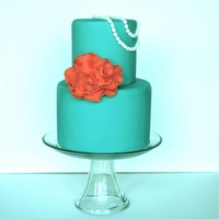 Teal Cake With Pearls This was a 6 inch and 4 inch round. Gumpaste fantasy flower and pearls.