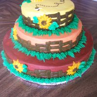 Sunflowers On A Fence I made this cake and entered it in our Local County Fair under the BC division.. I got first place and was well... Really excited.