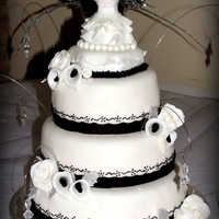 "Black And White Themed Cake For A ""white Dress Gala"" I made this 3 tier cake for a White Dress Gala at a local church. Top and bottom tiers are white cake with strawberry filling, and middle..."
